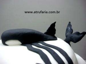A mascote baleia também em pasta americana.